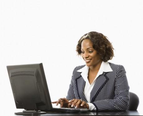 Freelance writer working at her computer.