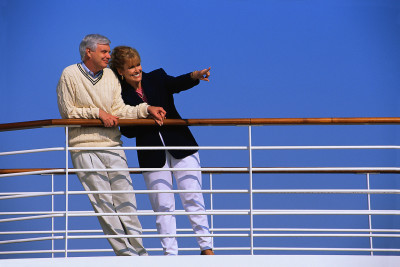 Couple Looking out over Railing of Cruise Ship